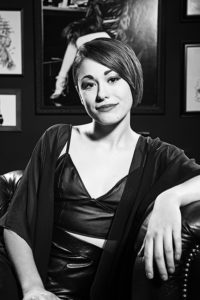 Black & white corporate portrait of a beautiful young woman with short hair