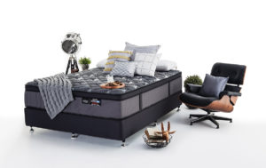 Product photography of a styled bedroom set shot against a pure white seamless background.