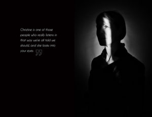 A black & white portrait of a woman with just a slit of light illuminating her eye