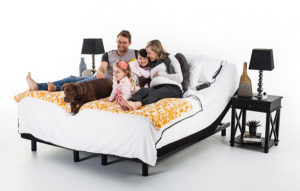 Image of a family and their dog enjoying time together on their adjustable bed