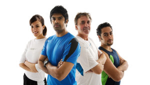 A photo of 4 multi-cultural athletes standing with their arms folded
