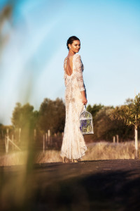 Photo of a bride holding a bird cage wearing her wedding gown designed by Gold Coast Bridal Lounge, Australia.