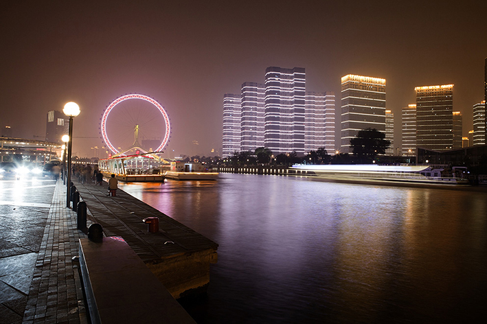 The serene Tianjin River by night.