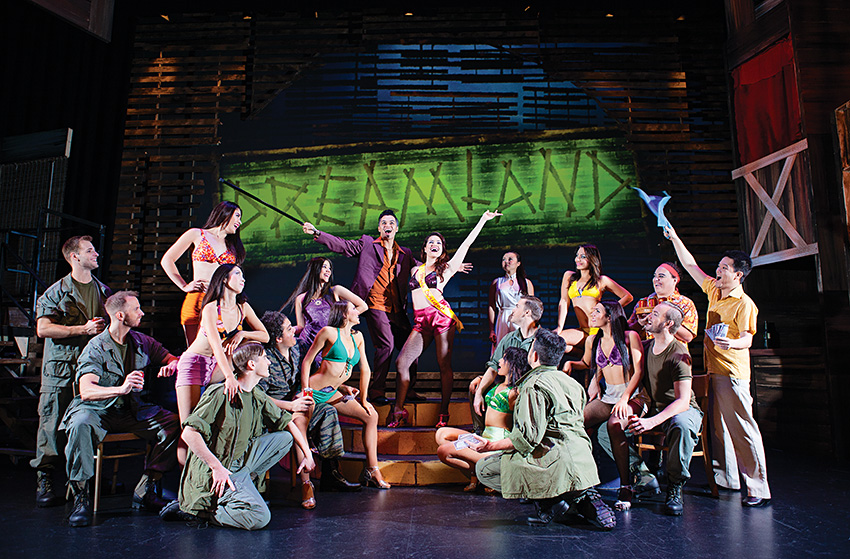 The cast of 'Miss Saigon' on the 'Dreamland' stage set at The Arts Centre Gold Coast's new musical theatre production