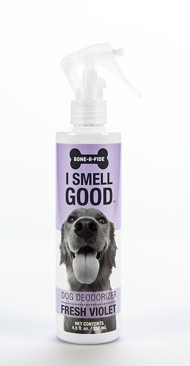 An image of a dog deodoriser spray bottle, sitting against a white background.