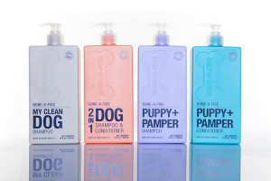 An image of 4 bottles of dog shampoo against a white background
