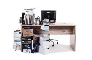 Product photograph of a desk which has been visually spliced in half to illustrate the messy 'before' and tidy 'after' appearances