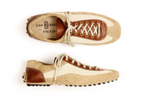 Product photography of men's brown canvas & leather casual shoes by Prada